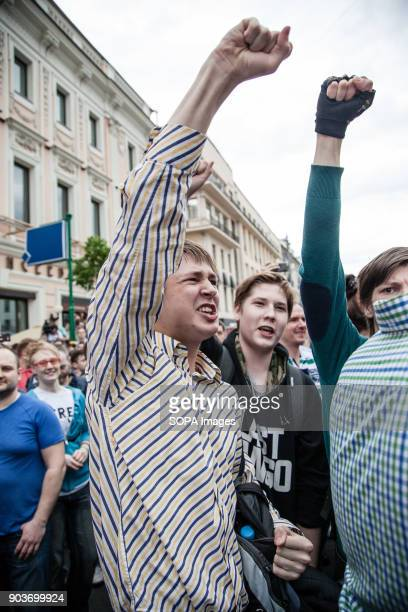 Protester rise their arm during the demonstration Anticorruption protest organised by opposition leader Alexei Navalny at Tverskaya Street