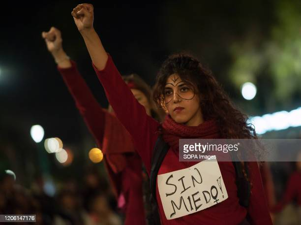 A protester rises her fist during the demonstration General women strike every 08 March coinciding with the International Women's Day thousands of...