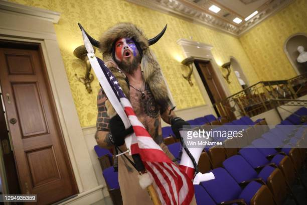 "Protester screams ""Freedom"" inside the Senate chamber after the U.S. Capitol was breached by a mob during a joint session of Congress on January 06,..."