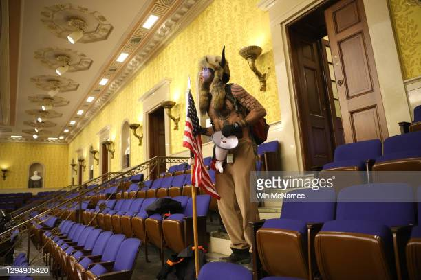 """Protester screams """"Freedom"""" inside the Senate chamber after the U.S. Capitol was breached by a mob during a joint session of Congress on January 06,..."""
