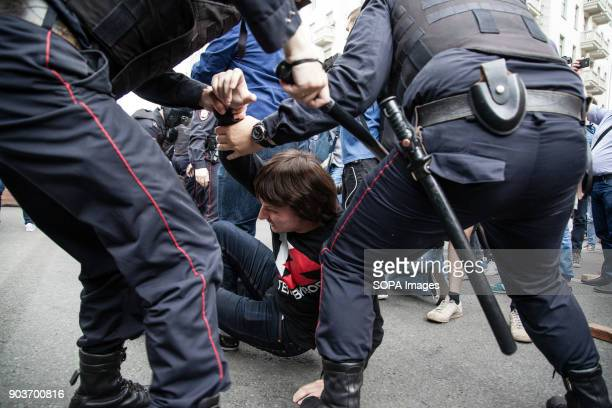 A protester seen being arrested by the police Anticorruption protest organised by opposition leader Alexei Navalny at Tverskaya Street