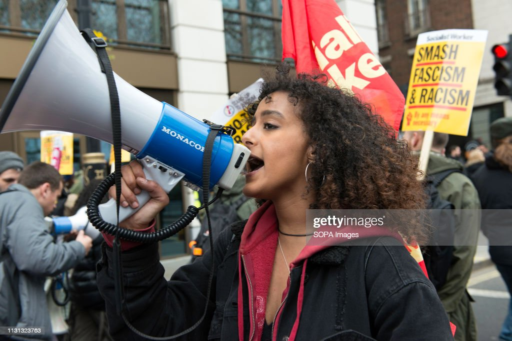 A protester seen chanting slogans on a megaphone during an... : News Photo