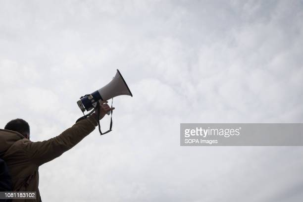 A protester seen chanting slogans on a megaphone during the protest Thousands of people protest to withdraw the Ministry of Education's plan on the...
