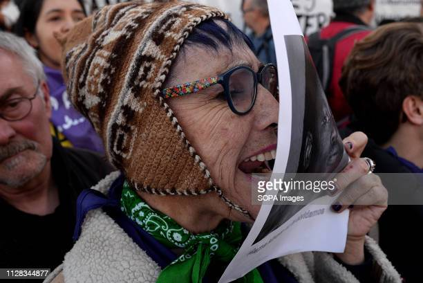 ALUCHE MADRID MADRID SPAIN A protester seen chanting slogans while holding a placard during the protest against racism in front of the Immigrant...