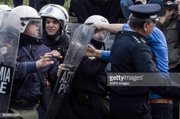 A protester seen clashing with the police during a demonstration against the education reform policy which is going to be voted by the Parliament...