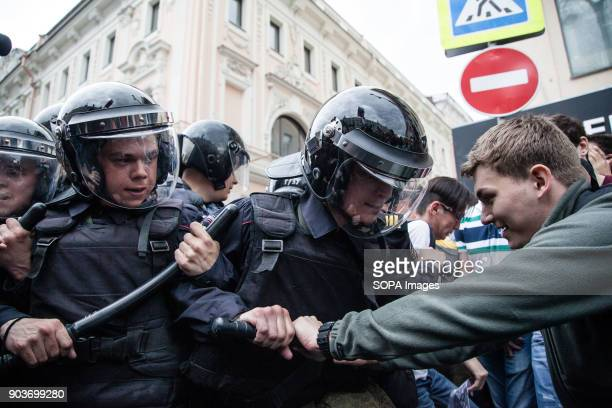 A protester seen crashing with the police Anticorruption protest organised by opposition leader Alexei Navalny at Tverskaya Street
