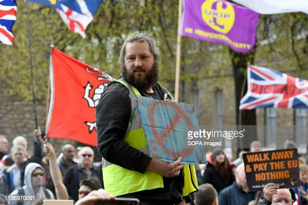 A protester seen holding a banner during the demonstration Protesters gathered at Parliament Square and marched to different places including Downing...