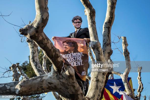 A protester seen holding a banner with the portrait of Carles Puigdemont painted on it during a demonstration to support Carles Puigdemont former...