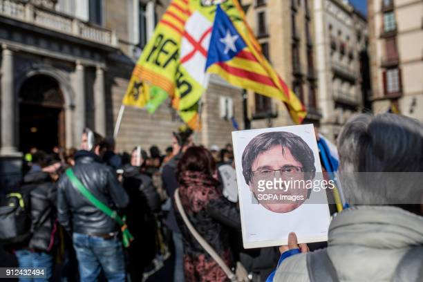 A protester seen holding a mask of Carles Puigdemont during a demonstration to support Carles Puigdemont former Catalan President in front of the...
