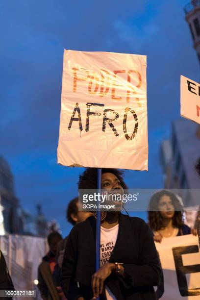 A protester seen holding a placard against racism during a demonstration against racism in Madrid Demonstrators demanded that white people repair the...