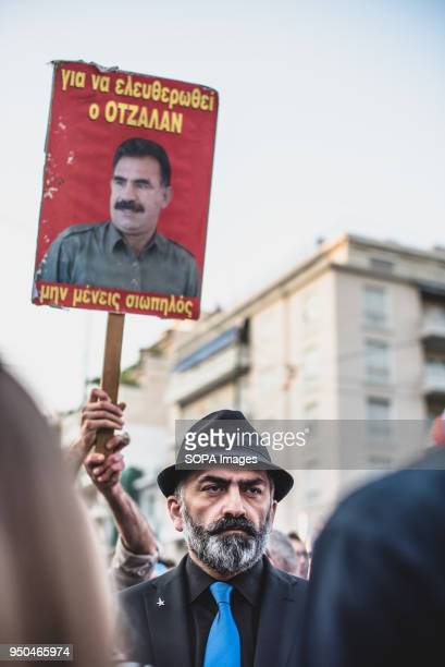 A protester seen holding a placard during a demonstration to mark the 103rd anniversary of the Armenian Genocide by Turkey Protesters marched to...
