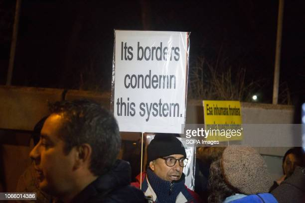 A protester seen holding a placard during a protest in front of the Immigration Detention Centre in Madrid Protesters were demanding the closure of...