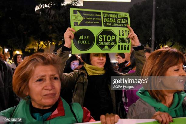 A protester seen holding a placard during the demonstration against the Spanish Supreme Court decision of clients and not the banks to pay the tax on...