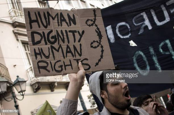 A protester seen holding a placard during the demonstration Demonstration for the International action day against racism fascism war and poverty...