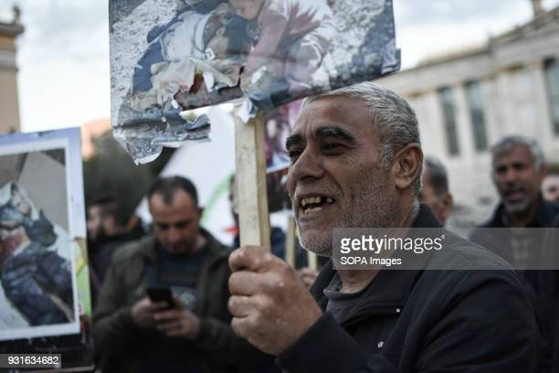 A protester seen holding a placard during the demonstration Kurds living in Athens marched toward the Turkish embassy the protest against the...