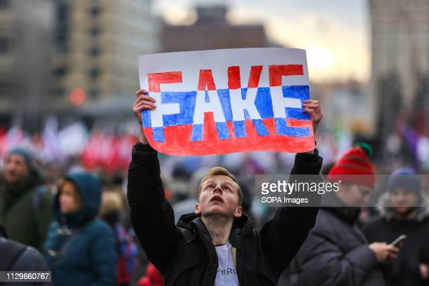 A protester seen holding a placard saying fake during the demonstration Participants in an opposition rally in central Moscow protest against...