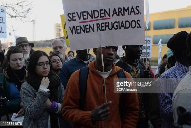 ALUCHE MADRID MADRID SPAIN A protester seen holding a placard saying guns are sold refugees come during the protest against racism in front of the...