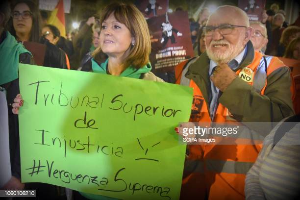 A protester seen holding a placard saying Shameful Supreme Court during the protest Hundreds of people from all parts of Spain protested against the...