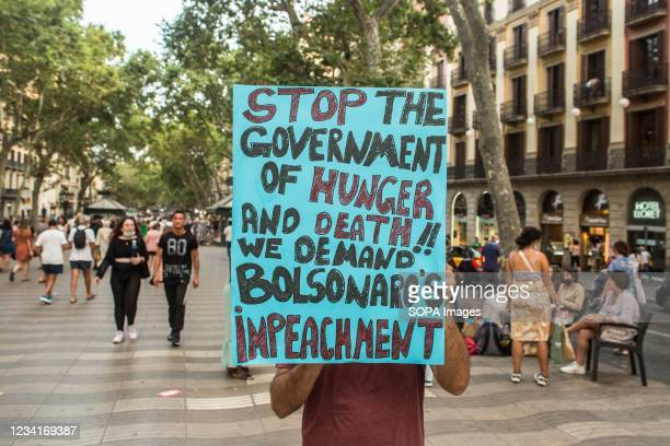 """Protester seen holding a placard saying """"stop government of hunger and death !! we demand Bolsonaro's impeachment during the demonstration. On..."""