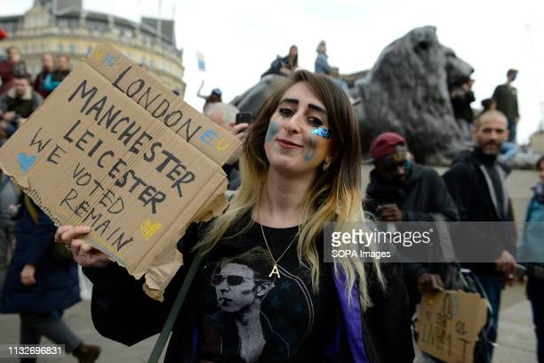 A protester seen holding a placard that says 'Manchester Leicester we voted remain' during the protest Over a million people marched peacefully in...