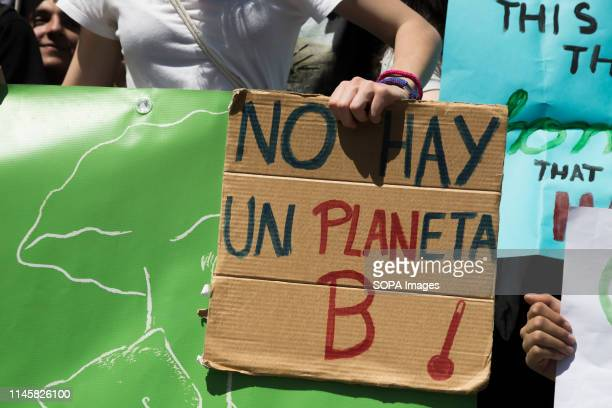 A protester seen holding a placard that says There is no planet B during the demonstration Hundreds of young Spaniards joined the international...
