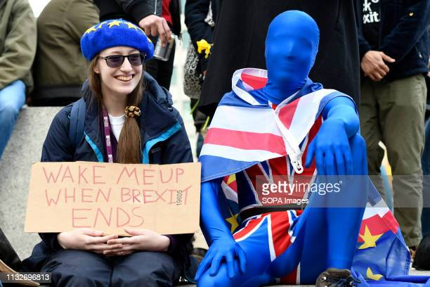 A protester seen holding a placard that says Wake me up when Brexit ends in Trafalgar Square during the demonstration Over a million people marched...