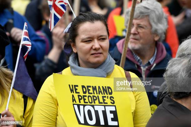 A protester seen holding a placard that says We demand a people's vote during the march Over a million people marched peacefully in central London in...