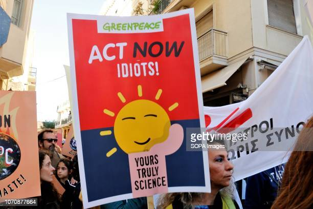 A protester seen holding a placardduring a protest calling for increased efforts to stop climate change