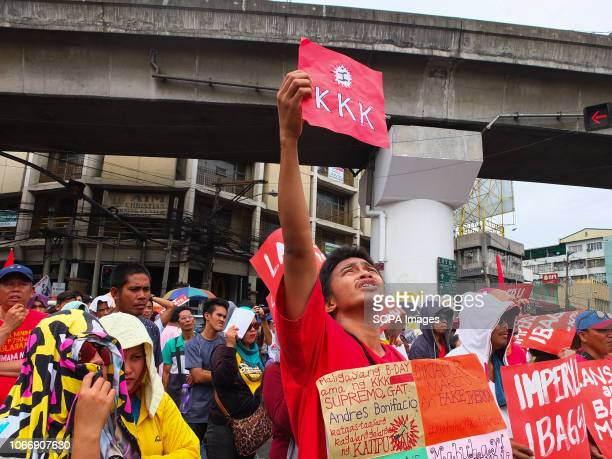 MENDIOLA MANILA PHILIPPINES A protester seen holding a red KKK placard during the protest Leftist groups stage Bonifacio Day of protest in Mendiola...