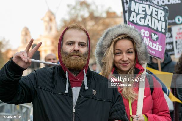 A protester seen holding an antiracist placard during the protest Huge crowds marched from the BBC in Portland Place to Whitehall with flags and...