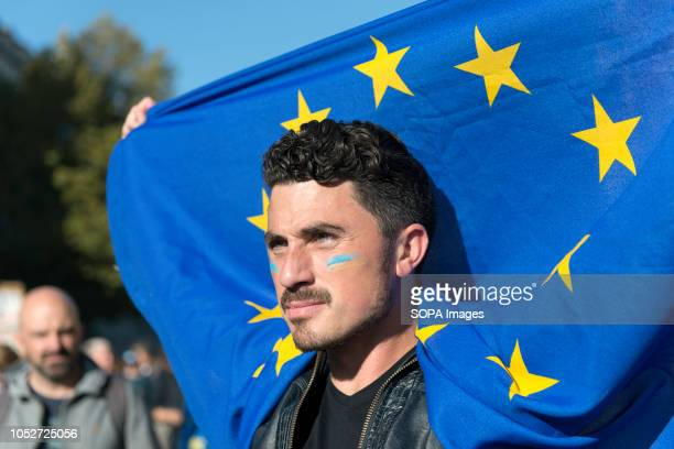 A protester seen holding an EU flag during a huge demonstration organised by the People's vote campaign The rally gathered at Park Lane and marched...