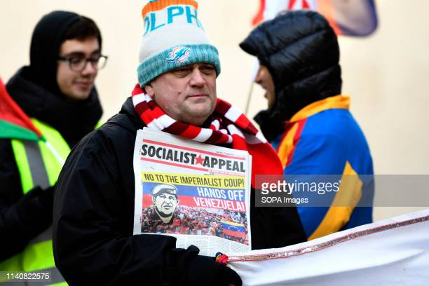 Protester seen holding the Socialist Appeal news paper during the Hands off Venezuela protest in London Protesters gathered outside BBC to protest...