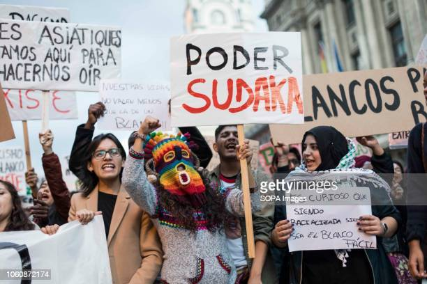A protester seen in an indigenous mask during a demonstration against racism in Madrid Demonstrators demanded that white people repair the damage...