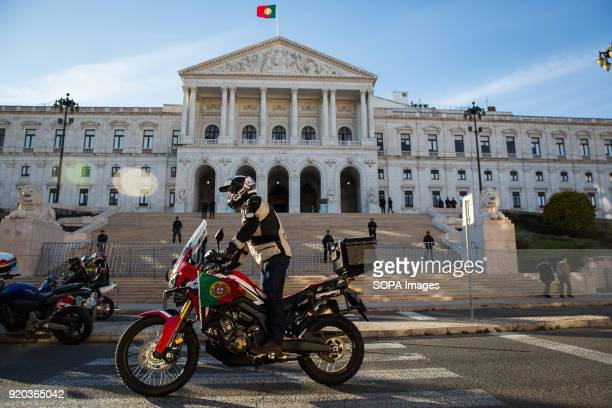 A protester seen riding a motorbike with the Portuguese flag print on it Thousands of motorcyclists demonstrated in several cities in Portugal to...