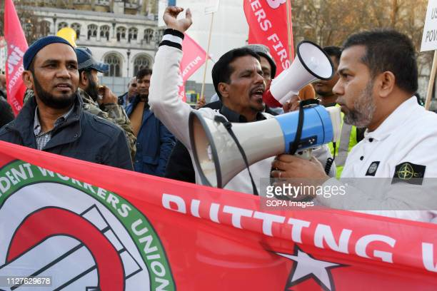 A protester seen shouting slogans against Transport for London on a megaphone during the demonstration Minicab drivers blocked Parliament Square in...