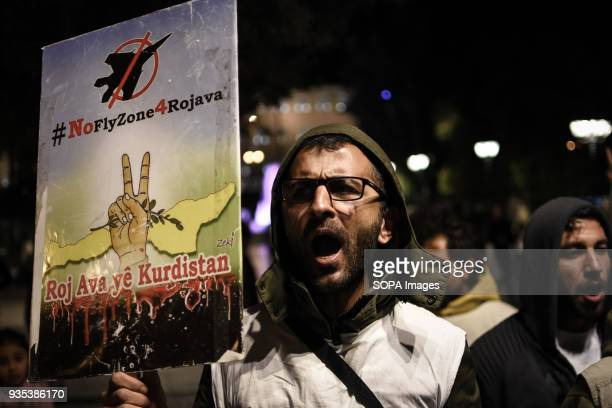 A protester seen shouting slogans while holding a placard at the demonstration Kurds living in Athens marched toward the Turkish embassy the protest...
