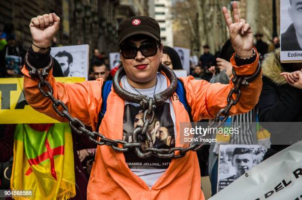 A protester seen showing herself chained in reference of the repression suffered by the people of the Rif Third March in Barcelona by the resistance...