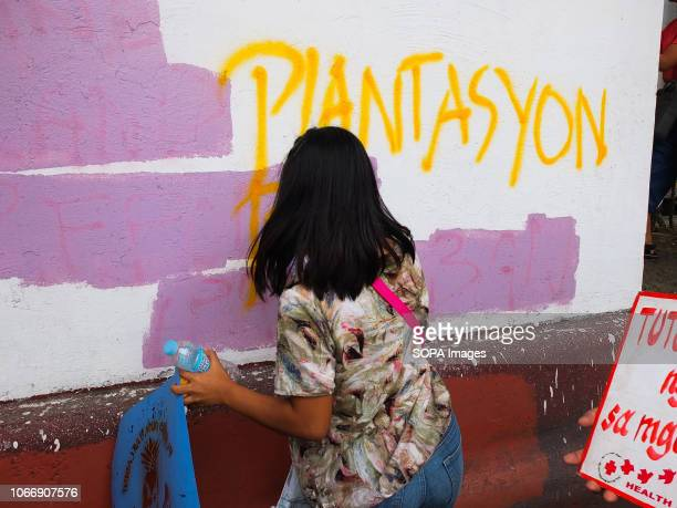 MENDIOLA MANILA PHILIPPINES A protester seen spraying paint on the wall during the protest Leftist groups stage Bonifacio Day of protest in Mendiola...