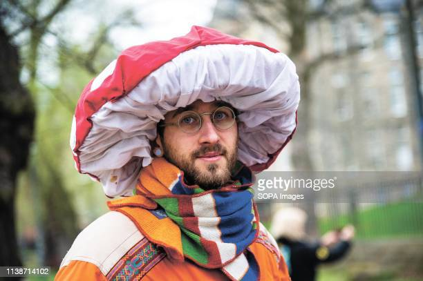 A protester seen wearing a mushroom hat during the demonstration Extinction Rebellion held a lockdown of Edinburgh's North Bridge as part of an...