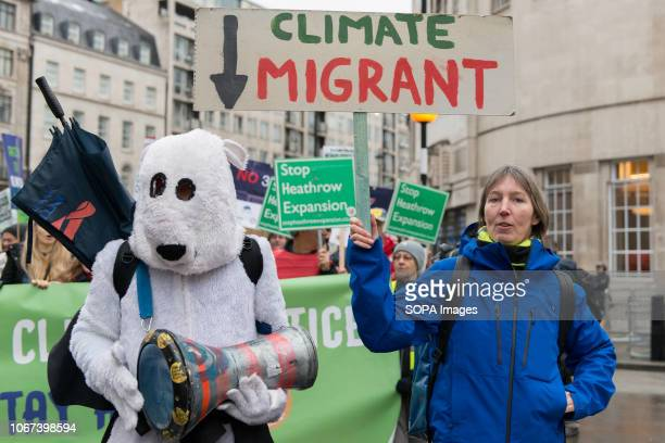 Protester seen wearing a polar bear costume Hundreds of people rallied in Portland Place near to the Polish embassy and marched to Downing Street in...
