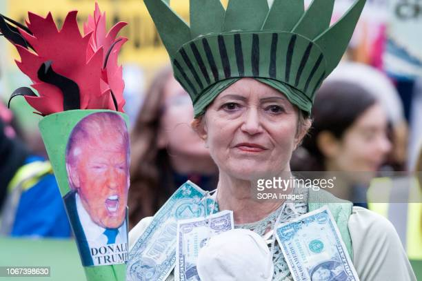 Protester seen wearing a statue of liberty costume Hundreds of people rallied in Portland Place near to the Polish embassy and marched to Downing...