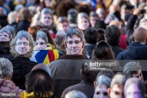 A protester seen with a mask of Carles Puigdemont on his head during a demonstration to support Carles Puigdemont former Catalan President in front...