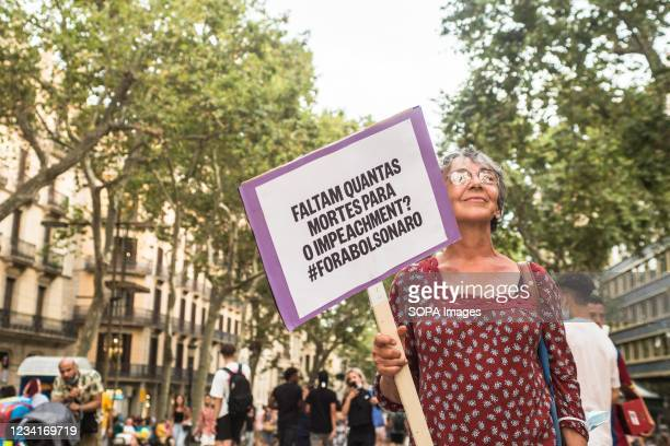 """Protester seen with a placard saying """"How many deaths are there for impeachment? during the demonstration. On Saturday, July 24, day marked by..."""
