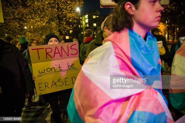 Protester seen wrapping herself with a flag during the protest Polish LGBTQ organizations protested under the slogan We Will Not Be Erased outside...