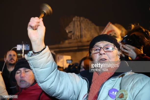 A protester shakes a bell on the Chain Bridge where demonstrators block the traffic after a protest against the policy of Hungarian government on...
