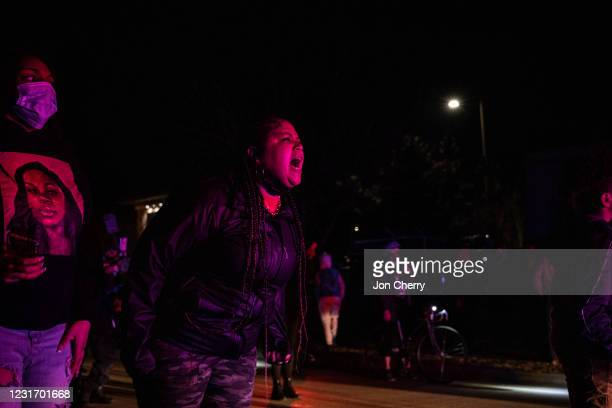 Protester shout at police officers in front of her and the crowd after the Breonna Taylor memorial events on March 13, 2021 in Louisville, Kentucky....