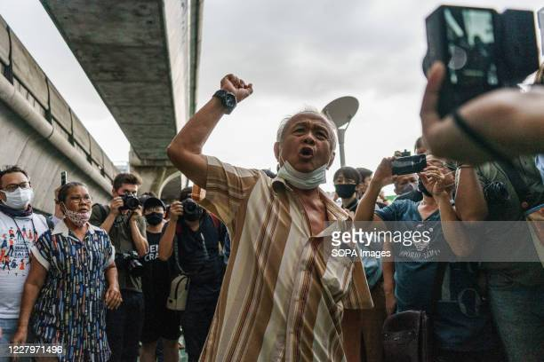 """Protester shouting """"Prayuth dick head"""" during the demonstration. People gathered around Pathum Wan Intersection protesting against the arresting of..."""