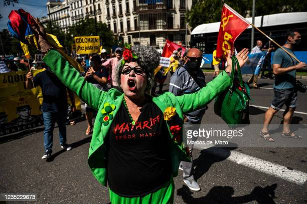 Protester shouting slogans during a demonstration against the visit to Madrid Book Fair 2021 of Colombian President Ivan Duque.