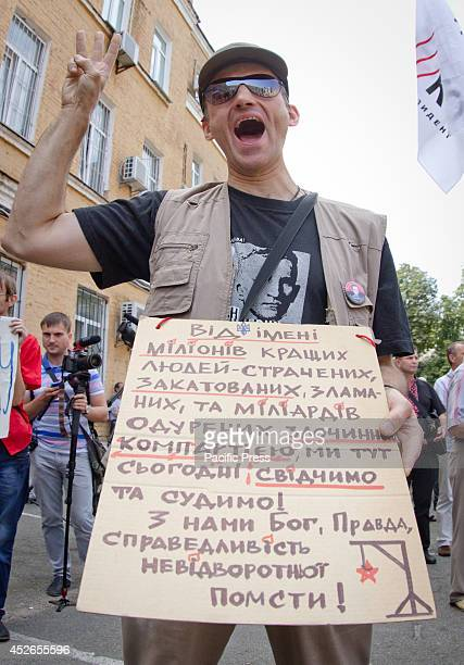 Protester shouts anticommunist slogans in front of Kiev county administrative court that starts a hearing to ban the Communist Party of Ukraine As...