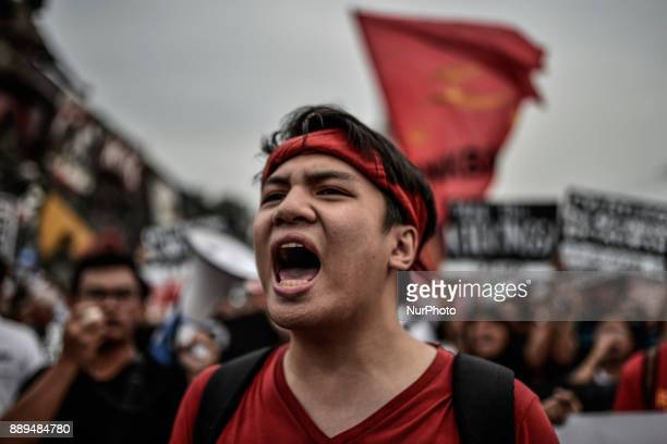 A protester shouts antigovernment slogans during Human Rights Day protests in Manila Philippines December 10 2017 On International Human Rights Day...